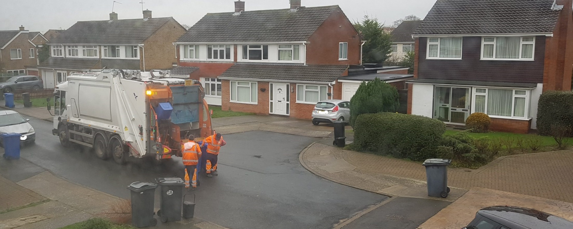 bin lorry collecting waste no plates