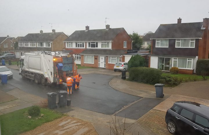 bin lorry collecting waste