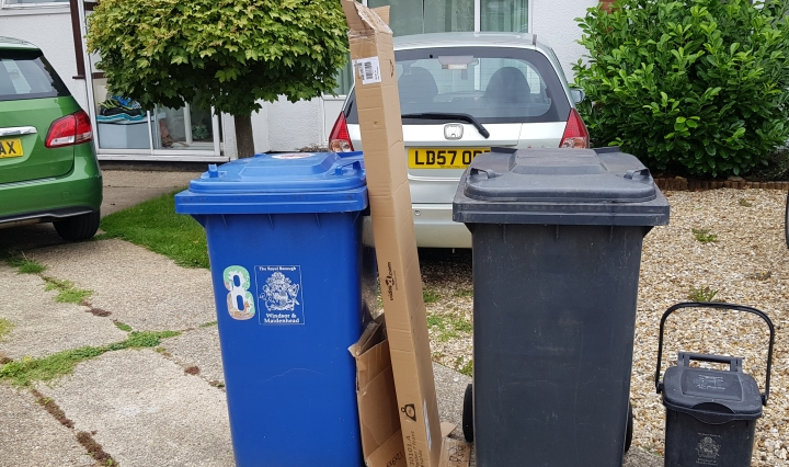 Cardboard next to bins